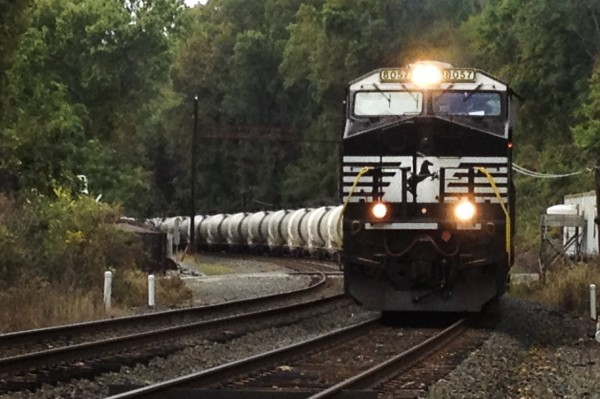 A train pulls oil tank units on its way to a refinery in Delaware. As U.S. oil production outpaces its pipeline capacity, more and more companies are looking to the railways to transport crude oil.